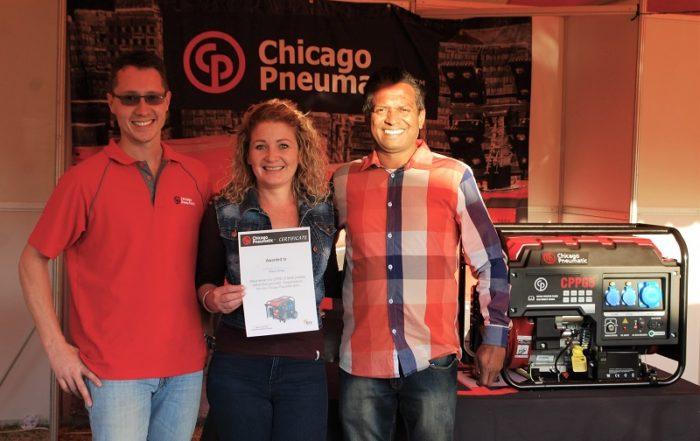 From left: Eben van der Vyver with Natashia Boshoff (winner) and Leon Govender. Image credit: Chicago Pneumatic