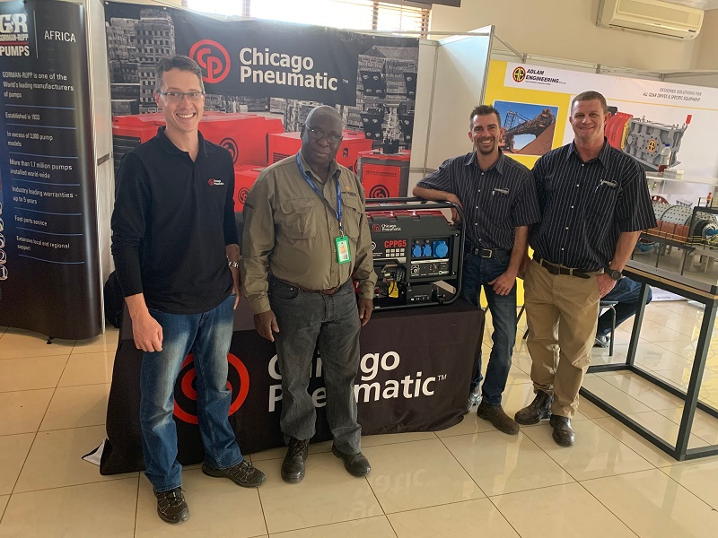 From left: Eben van der Vyver and Kalumbila winner Levy Mweemba with Seth Jansen and Jonathan Burns. Image credit: Chicago Pneumatic