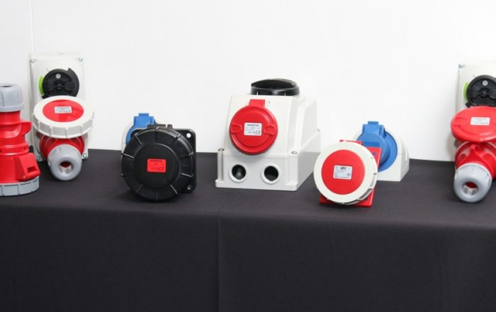 Powermite's plastic range of couplers (far right), switched interlocked sockets for wall mounting, flanged inlet straight, sockets from AMPCO. Image credit: Powermite