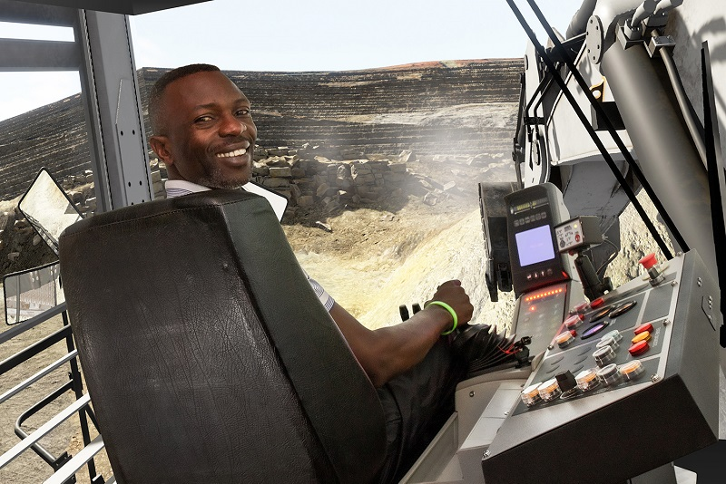 Operator on the Cybermine Liebherr 9350 Simulator. Photo by ThoroughTec