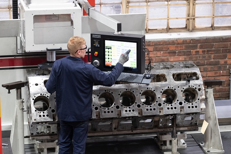 A machinist at Metric Automotive Engineering double checking setup parameters prior to machining a 16-cylinder block. Photo by Metric Automotive Engineering