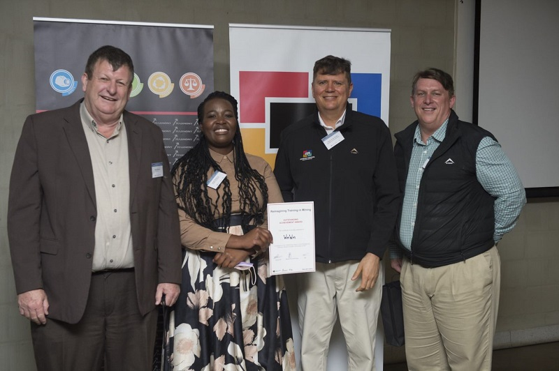 From left: Peter Steenkamp, CEO of Harmony Gold, and Sietse van der Woude, Senior Executive of Modernisation and Safety at the Minerals Council, with winners Win Win. Image credit: ©African Mining, Incorporating Mining Mirror